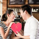 43779411 - asian couple, woman and man, having date in coffee shop with red heart, flirting or celebrating anniversary